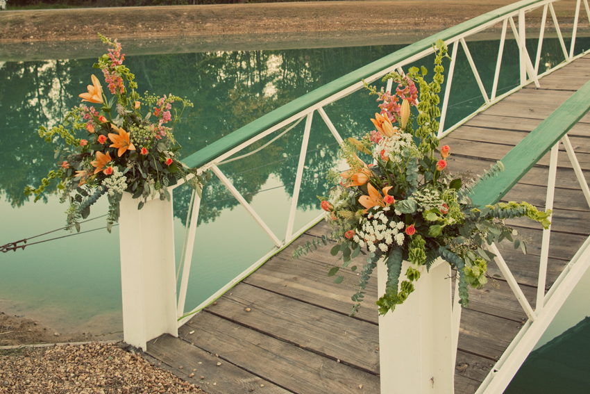 Flowers on Bridge to Island for Wedding Aisle © Marni Mattner Photography