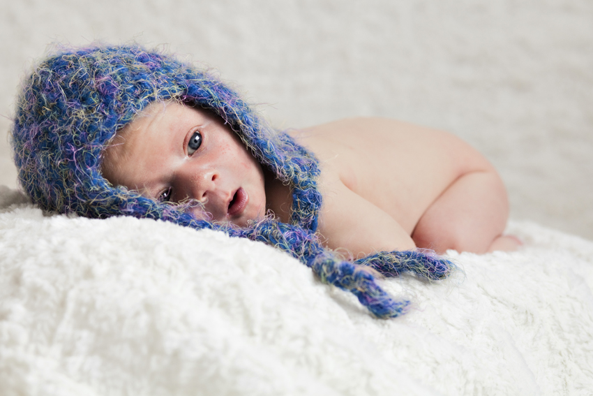 Infant photography of Logan in a blue stocking cap (c) Marni Mattner Photography