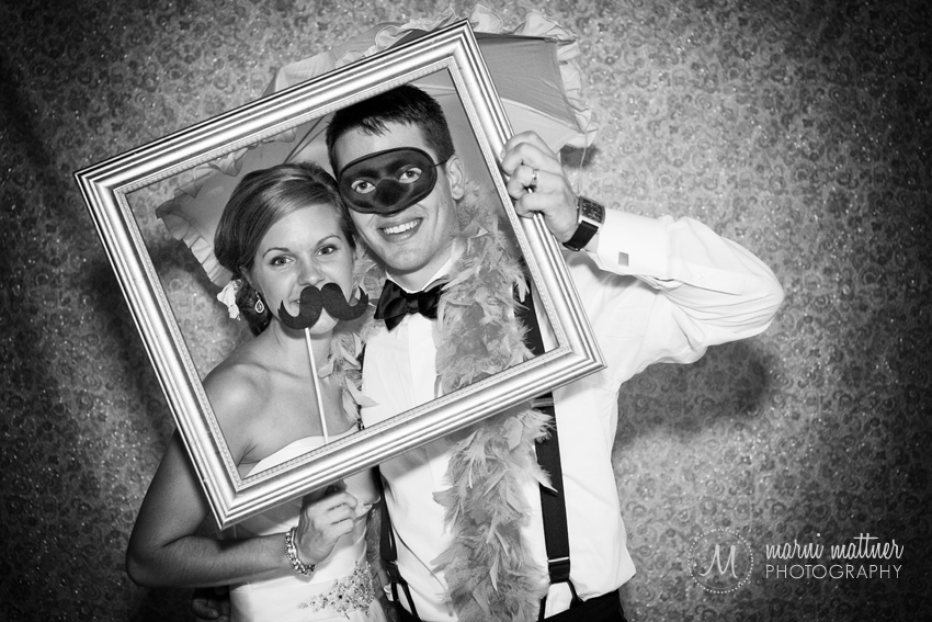 Bride &amp; Groom in Photo Booth  Marni Mattner Photography