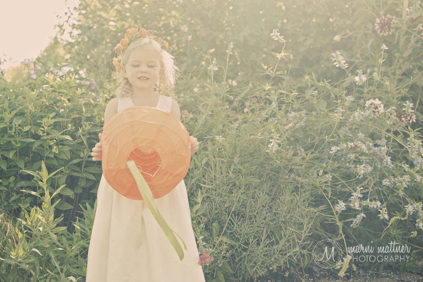 Flower Girl With Paper Lantern In The Gardens In Healdsburg, CA Wedding © Marni Mattner Photography