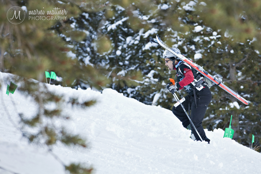Boot Packing Skis Uphill During Sprint Race © Marni Mattner Photography