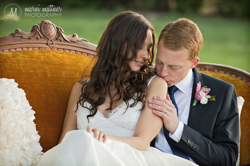 The Newlyweds on a Vintage Couch After Wedding Ceremony  Marni Mattner Photography