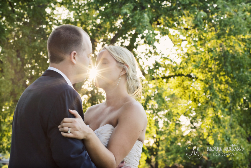 Groom and Bride sharing a sunset kiss in Denver's Wash Park © Marni Mattner Photography
