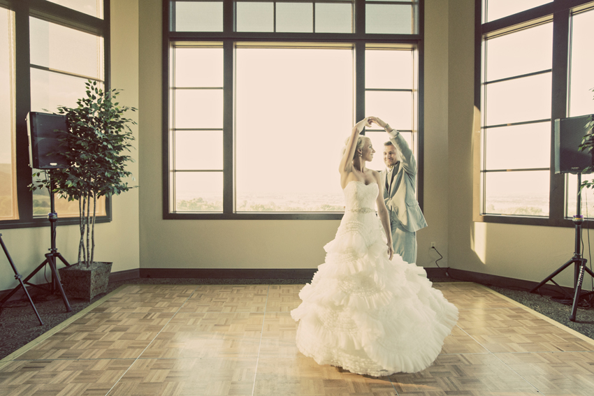 Groom Twirls Bride During First Dance © Marni Mattner Photography