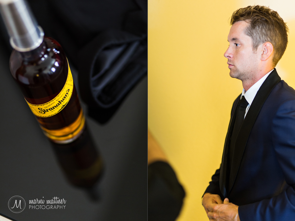 Britton putting on his suit coat, along with the groomsmen gift of Denver's Stranahan's whiskey