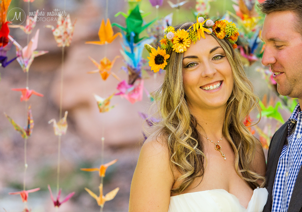 The bride wore a flower crown and paper cranes decorated the trees at this Riverbend wedding in Lyons, CO