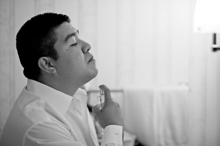 Groom getting ready for wedding at JW Marriott © Marni Mattner Photography