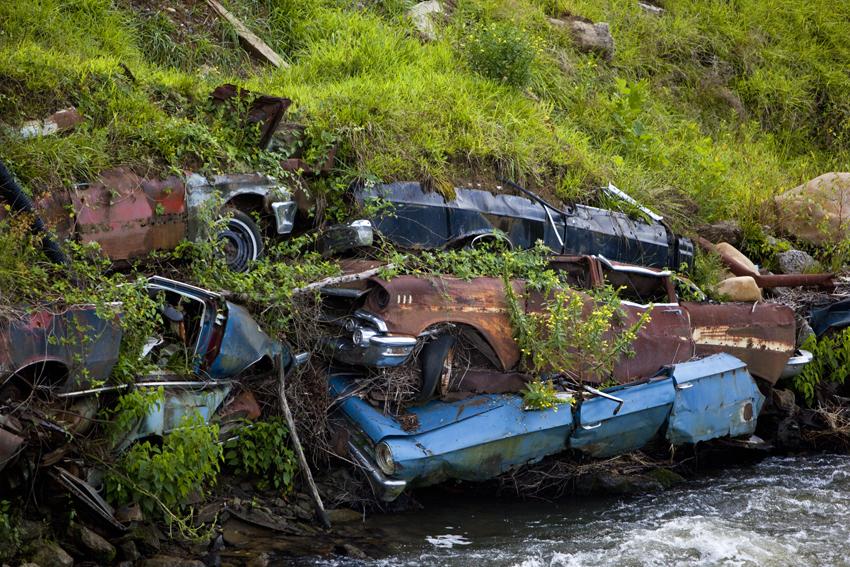 Smoky Mountain Riverbank Shored Up By Cars in North Carolina © Marni Mattner Photography