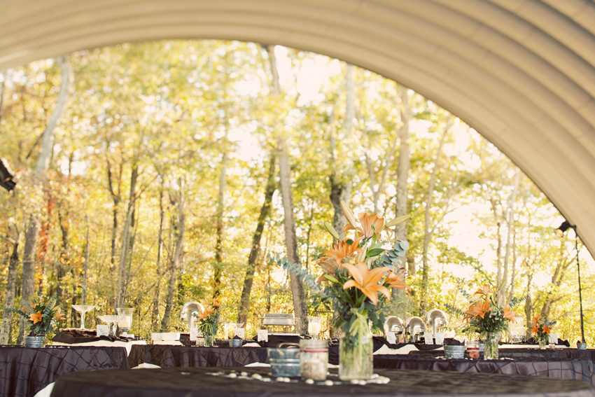 Open-Air Airplane Hangar Where Reception Was Held with DIY Centerpieces © Marni Mattner Photography