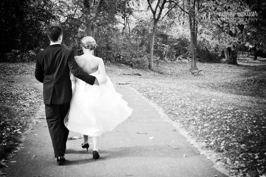 Bride & Groom Strolling Through the Cambridge, MN Park © Marni Mattner Photography