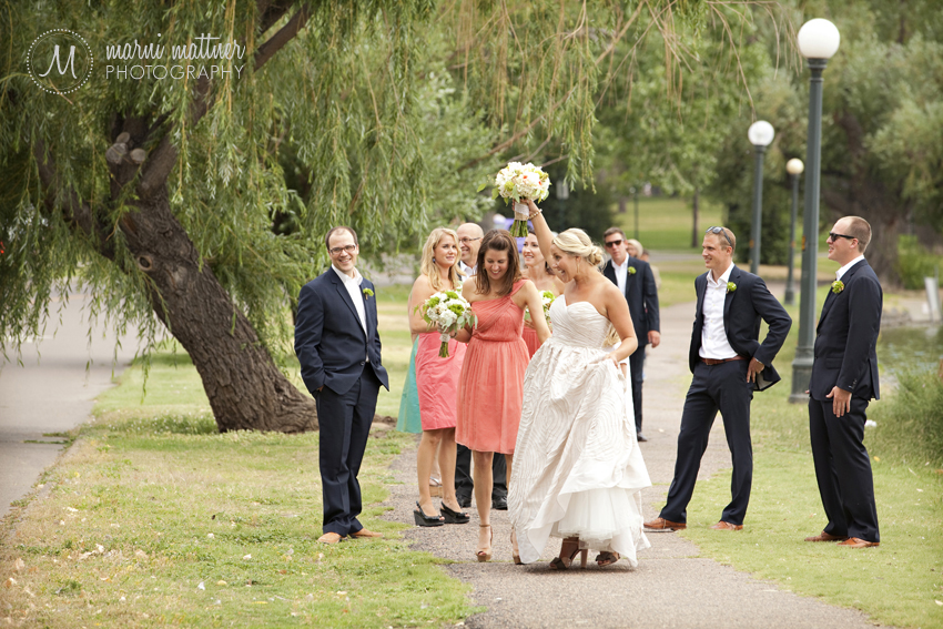 Megan, Logan & their wedding party walking to the ceremony at Wash Park in Denver © Marni Mattner Photography