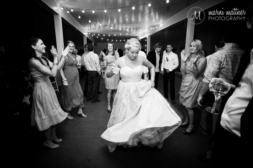 Megan tears it up on the dance floor at her wedding reception in Wash Park's boathouse © Marni Mattner Photography