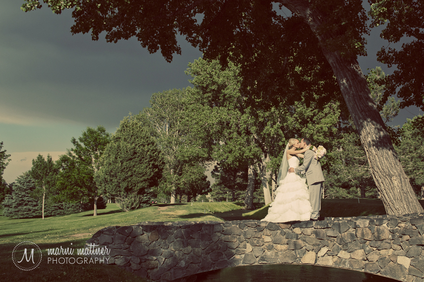 Bride and Groom Atop A Stone Wall © Marni Mattner Photography
