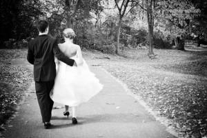 Bride & Groom Strolling Through the Cambridge, MN Park © Marni Mattner Photography
