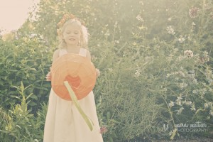 Flower Girl With Paper Lantern In The Gardens In Healdsburg, CA Wedding © Marni Mattner Photography